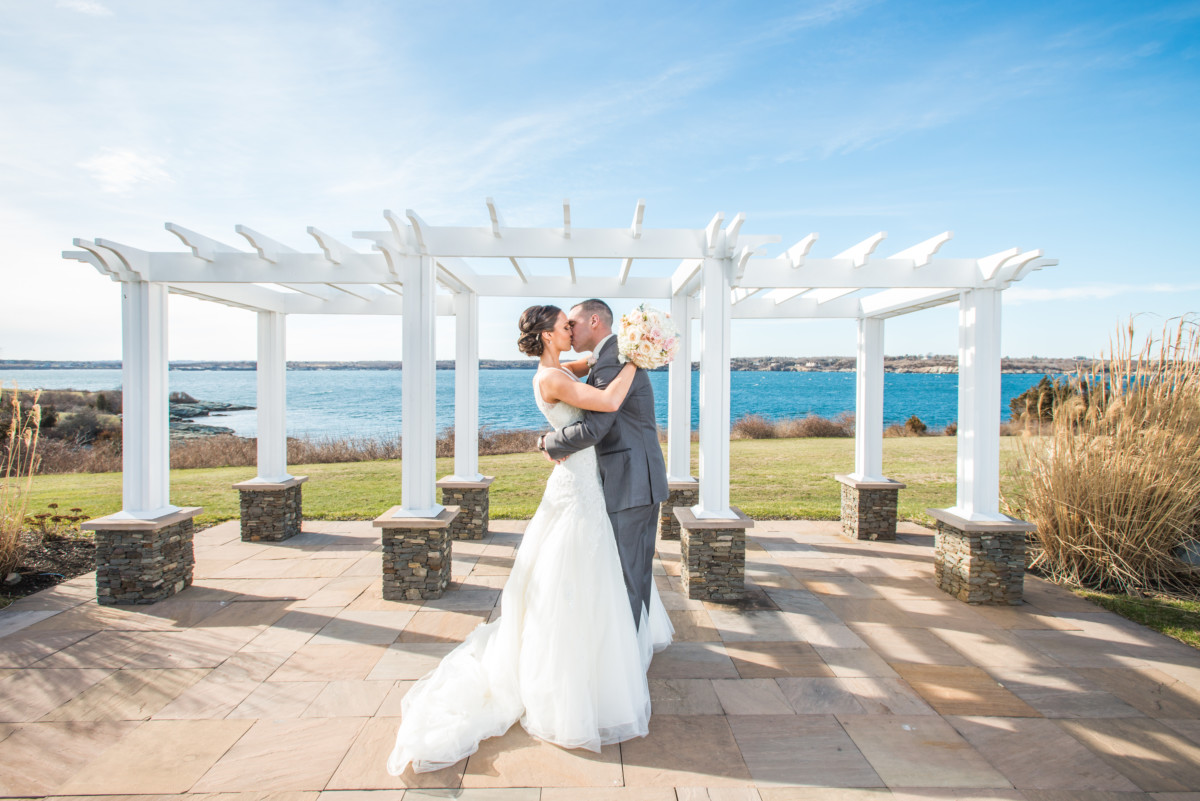Wedding at OceanCliff | Kiss under the arbor