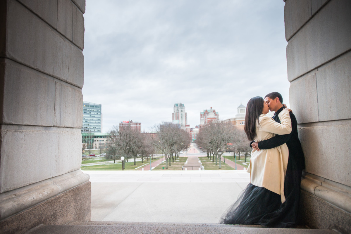 Downtown Providence Engagement - Kiss overlooking the statehouse lawn