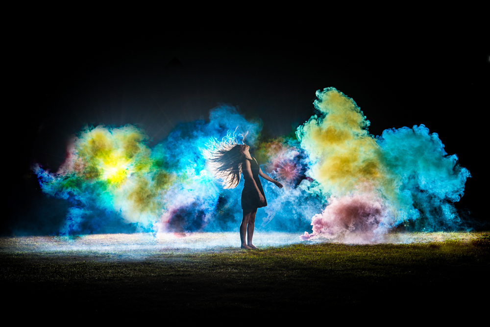 Girl in front of colored smoke at night - business consulting services for Rhode Island 1