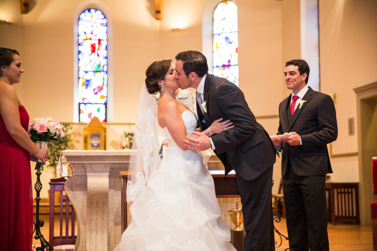 Lauren and Jimmy | Wedding at the Providence Biltmore | First kiss at PC chapel