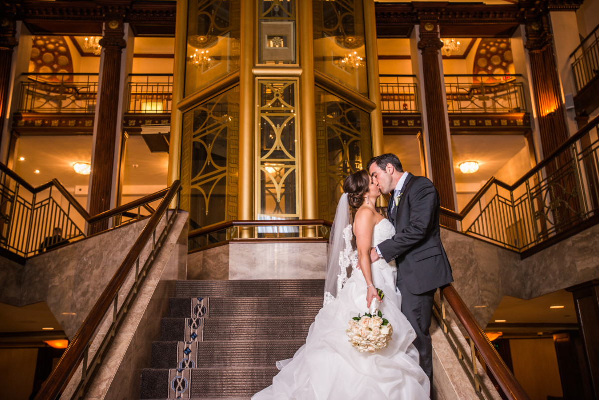 Lauren and Jimmy | Wedding at the Providence Biltmore | Bride and groom on grand staircase